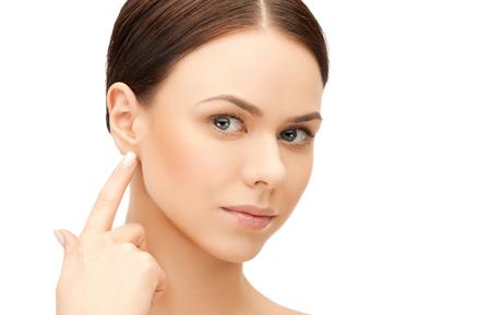 face of beautiful woman touching her ear