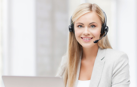 Photo for smiling female helpline operator with headphones and laptop - Royalty Free Image