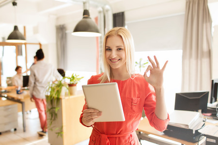 Photo for business, startup and people concept - happy businesswoman or creative female office worker with tablet pc computer showing ok hand sign - Royalty Free Image
