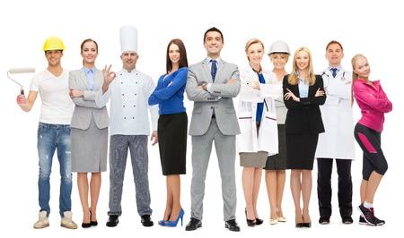 Foto de happy businessman over group of professional workers - Imagen libre de derechos