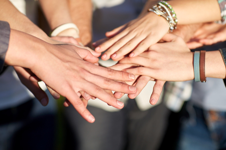 Photo pour close up of students or teenagers with hands outdoors - image libre de droit
