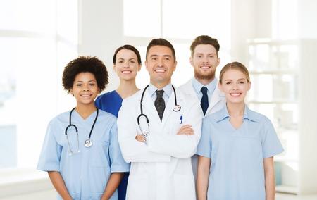 Photo pour hospital, profession, people and medicine concept - group of happy doctors at hospital - image libre de droit