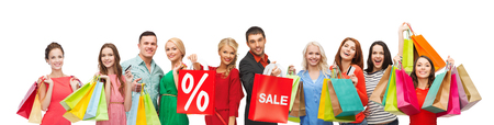 consumerism, people and discount concept - group of happy people with percentage and sale sign on shopping bags