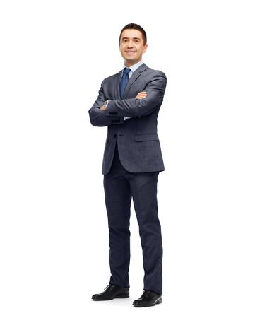 Foto de business, people and office concept - happy smiling businessman in dark grey suit - Imagen libre de derechos
