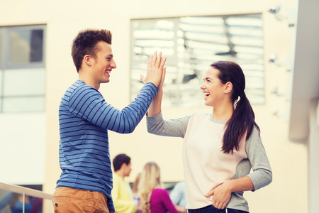 Photo for friendship, gesture, education and people concept - group of smiling students outdoors making high five - Royalty Free Image
