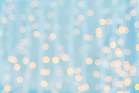 blurred blue and golden background with bokeh lights