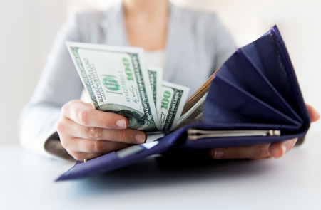 Photo pour business, finance, saving, banking and people concept - close up of woman hands with wallet and us dollar money - image libre de droit