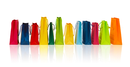 sale, consumerism, advertisement and retail concept - many colorful shopping bags