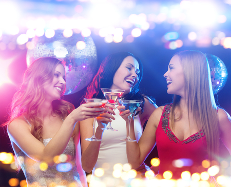 Photo for holidays, nightlife, bachelorette party and people concept - smiling women with cocktails at night club - Royalty Free Image