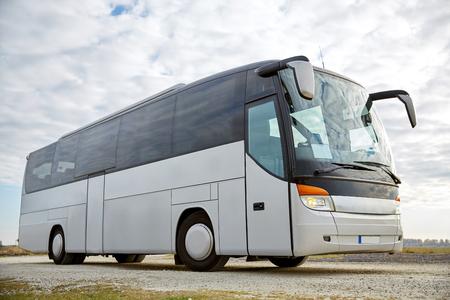 Photo pour travel, tourism, road trip and passenger transport - tour bus parked outdoors - image libre de droit