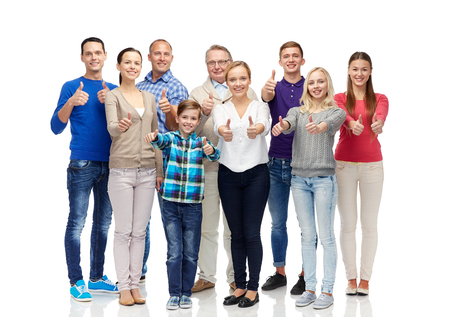 Foto de gesture, family, generation and people concept - group of smiling men, women and boy showing thumbs up - Imagen libre de derechos