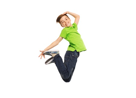 Photo for happiness, childhood, freedom, movement and people concept - smiling boy jumping in air - Royalty Free Image