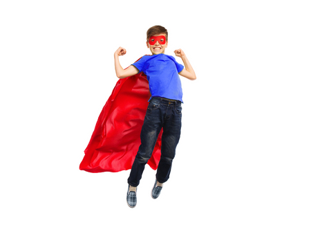 Photo pour happiness, freedom, childhood, movement and people concept - boy in red super hero cape and mask flying in air - image libre de droit