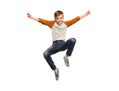 Photo pour happiness, childhood, freedom, movement and people concept - happy smiling boy jumping in air - image libre de droit