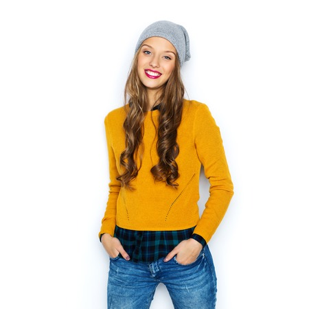 Photo for people, style and fashion concept - happy young woman or teen girl in casual clothes and hipster hat - Royalty Free Image