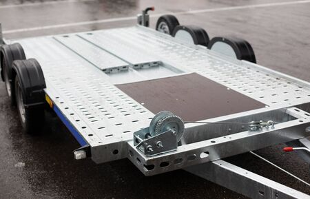 Foto de transportation and equipment concept - close up of trailer outdoors - Imagen libre de derechos