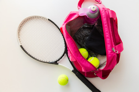 Photo pour sport, fitness, healthy lifestyle and objects concept - close up of tennis racket and balls with female sports bag - image libre de droit