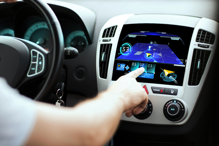 Foto de transport, destination, modern technology and people concept - male hand searching for route using navigation system on car dashboard screen - Imagen libre de derechos