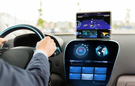 Photo pour transport, destination, modern technology and people concept - close up of man driving car with navigation system on tablet pc computer - image libre de droit