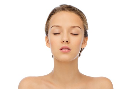 beauty, people and health concept - young woman face with closed eyes and shoulders