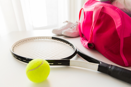 Foto de sport, fitness, healthy lifestyle and objects concept - close up of tennis racket and balls with female sports bag - Imagen libre de derechos