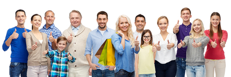 Photo for gesture, sale, shopping and people concept - group of smiling men, women and kids showing thumbs up and holding shopping bags - Royalty Free Image