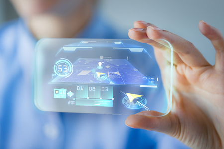 business, technology, navigation system and people concept - close up of woman hand holding and showing transparent smartphone with navigator on screen