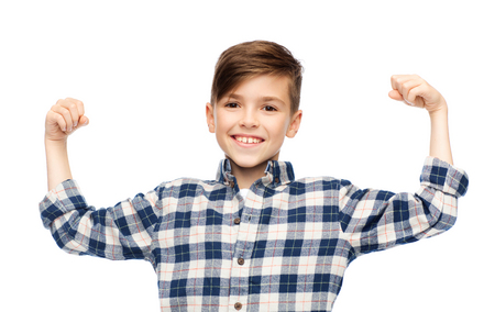 Photo pour childhood, power, strength and people concept - happy smiling boy in checkered shirt showing strong fists - image libre de droit