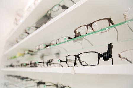 Photo pour optics, health care and vision concept - close up of eyeglasses at optician - image libre de droit