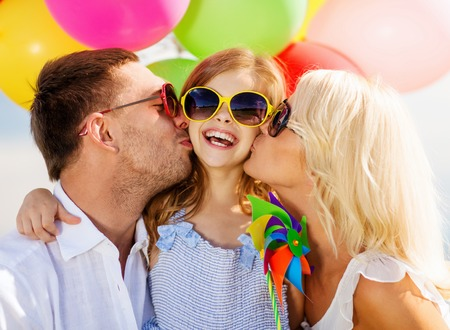Photo for summer holidays, celebration, children and people concept - family with colorful balloons - Royalty Free Image