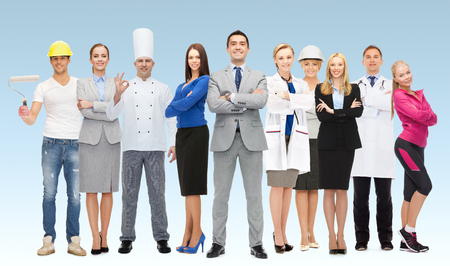 people, profession, qualification, employment and success concept - happy businessman with group of professional workers over blue background