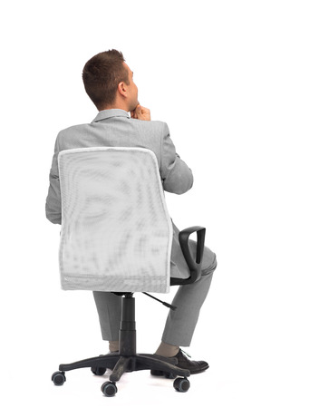 business, people, furniture, rear view and office concept - businessman sitting in office chair from backの写真素材