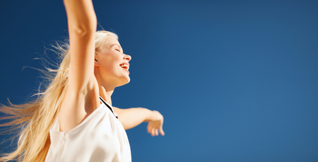 Photo for people, happiness, freedom and summer concept - beautiful happy woman enjoying sun outdoors - Royalty Free Image