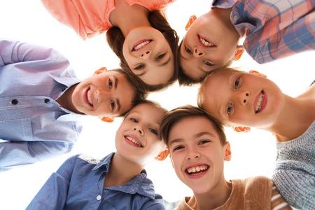 Photo pour childhood, fashion, friendship and people concept - happy smiling children faces - image libre de droit