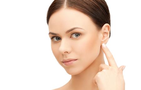 Foto für face of beautiful woman touching her ear - Lizenzfreies Bild
