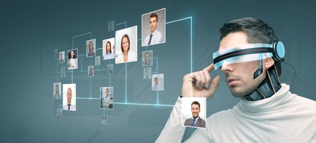 Foto de people, technology, future and progress - man with futuristic 3d glasses and microchip implant or sensors over blue background with network contacts icons - Imagen libre de derechos