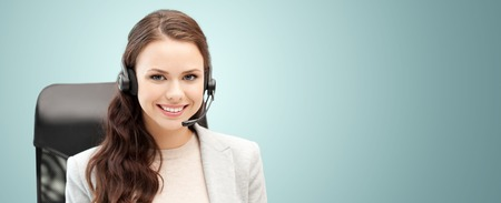 Photo for people, online service, communication and technology concept - smiling female helpline operator with headset over blue background - Royalty Free Image