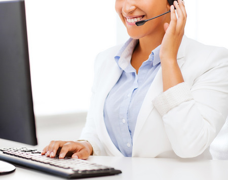 Photo pour business, office and communication concept - african female helpline operator with headphones - image libre de droit
