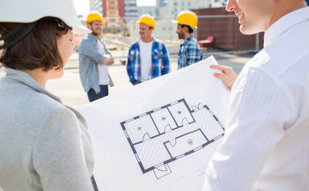 Photo pour construction, architecture, business, teamwork and people concept - close up of architects with blueprint at building site - image libre de droit