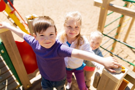 Photo pour summer, childhood, leisure, friendship and people concept - group of happy kids on children playground - image libre de droit
