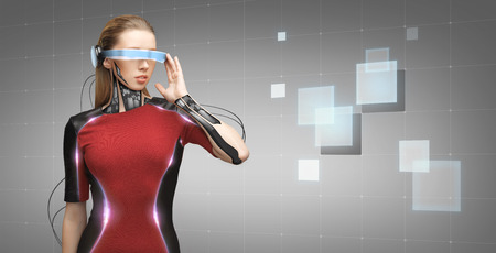 Photo pour people, technology, future and progress - young woman with futuristic glasses and microchip implant or sensors over gray background with grid and squares - image libre de droit