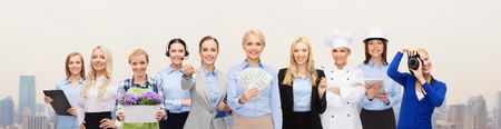 Photo pour people, profession, employment, compensation and finances concept - happy businesswoman holding dollar money with group of professional workers over city background - image libre de droit