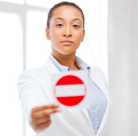 Photo pour business, protest, racism concept - african woman showing stop sign - image libre de droit