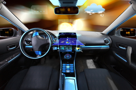 Foto de transport, destination and modern technology concept - car salon with navigation system on dashboard and meteo sensor on windshield over night lights background - Imagen libre de derechos