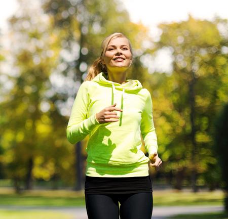 Photo pour fitness and lifestyle concept - female runner jogging outdoors - image libre de droit