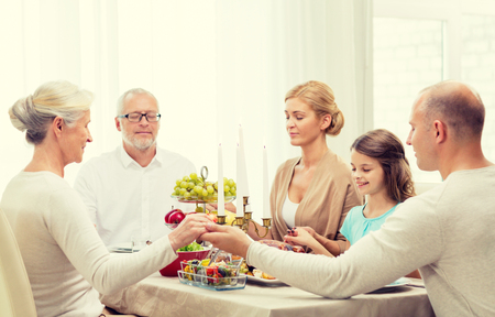 Photo for family, holidays, generation and people concept - smiling family having dinner and praying at home - Royalty Free Image