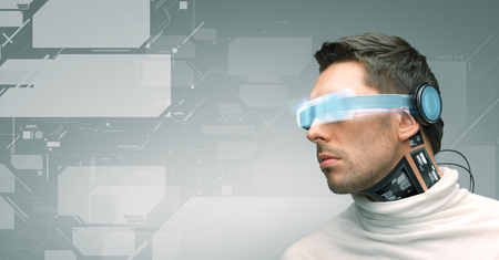 Photo pour people, technology, future and progress - man with futuristic glasses and microchip implant or sensors over gray background and virtual screens - image libre de droit