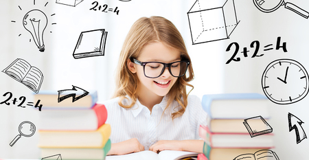 Photo for education and school concept - little student girl studying and reading books at school - Royalty Free Image