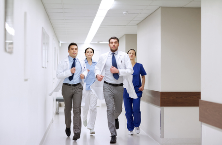 Photo pour clinic, people, health care and medicine concept - group of medics runing along hospital - image libre de droit