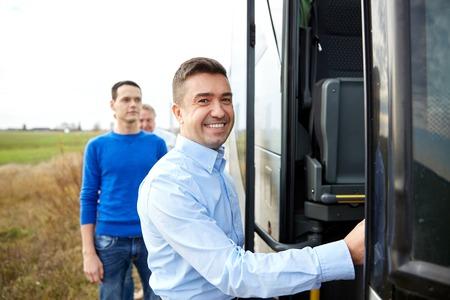 Photo pour transport, tourism, road trip and people concept - group of happy male passengers boarding travel bus - image libre de droit